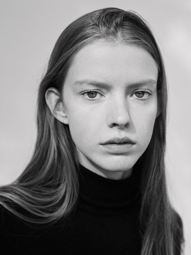 Black and white photograph of model Charlotte Walker from Elite model management