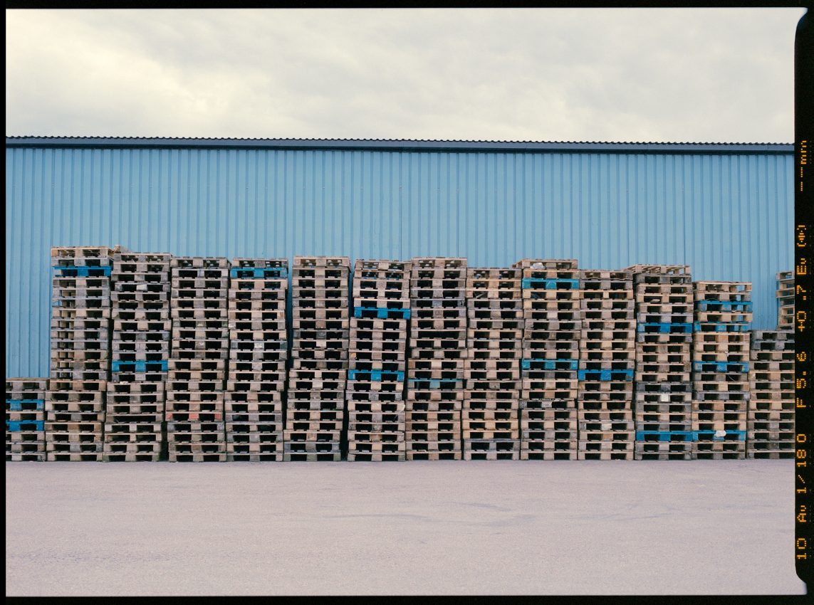 medium format colour film photograph of shipping pallets in Gothenburg Sweden
