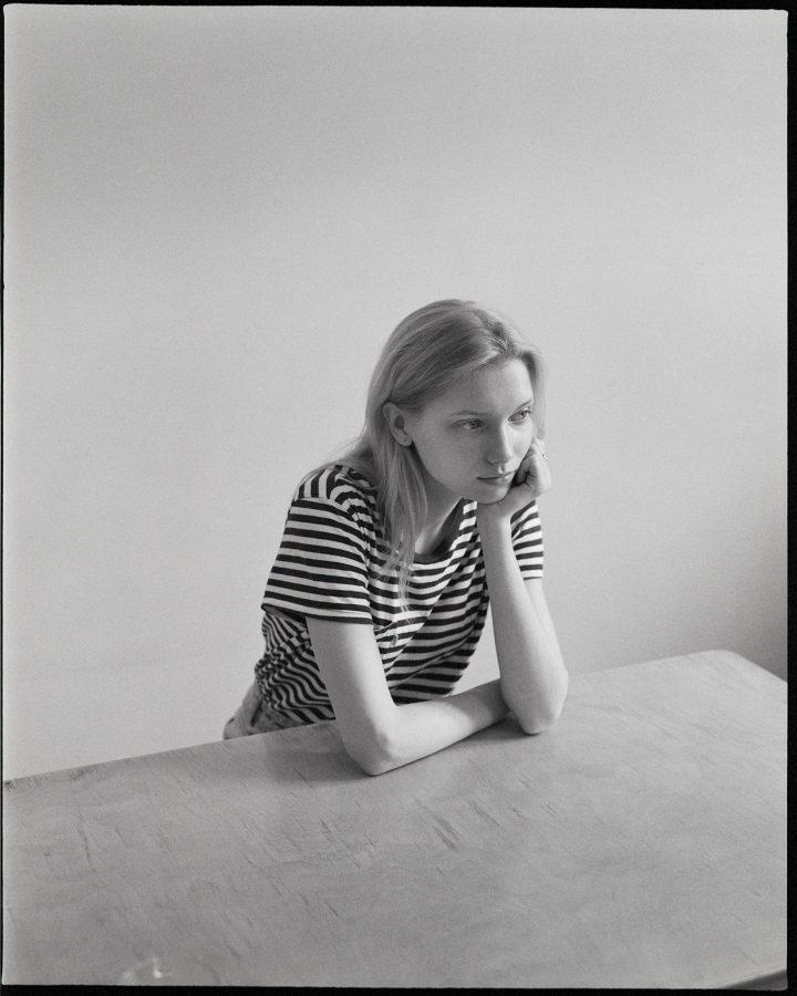 Portrait of Model Vika from Trend Management sitting at a table