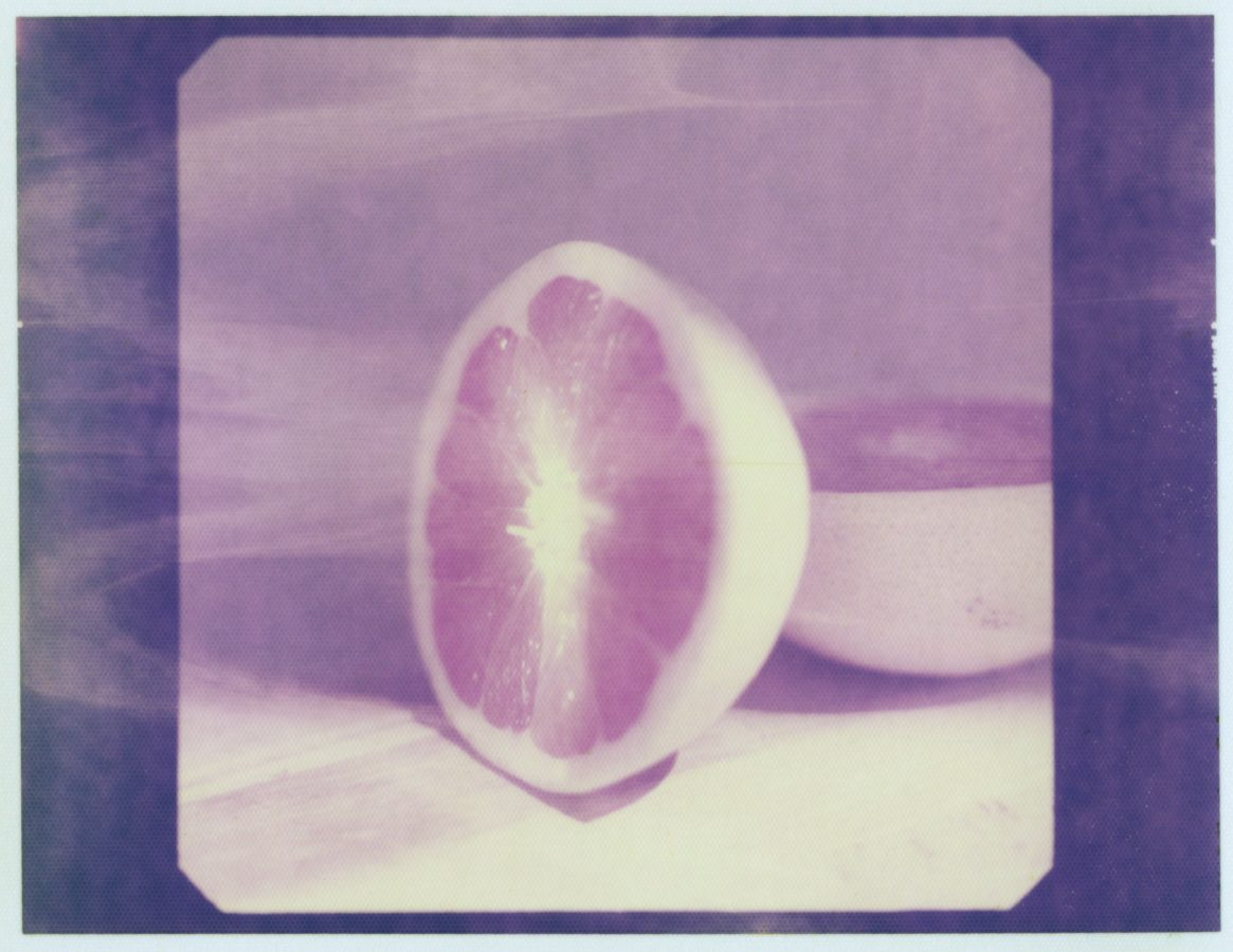 Polaroid instant image of a grapefruit cut in half